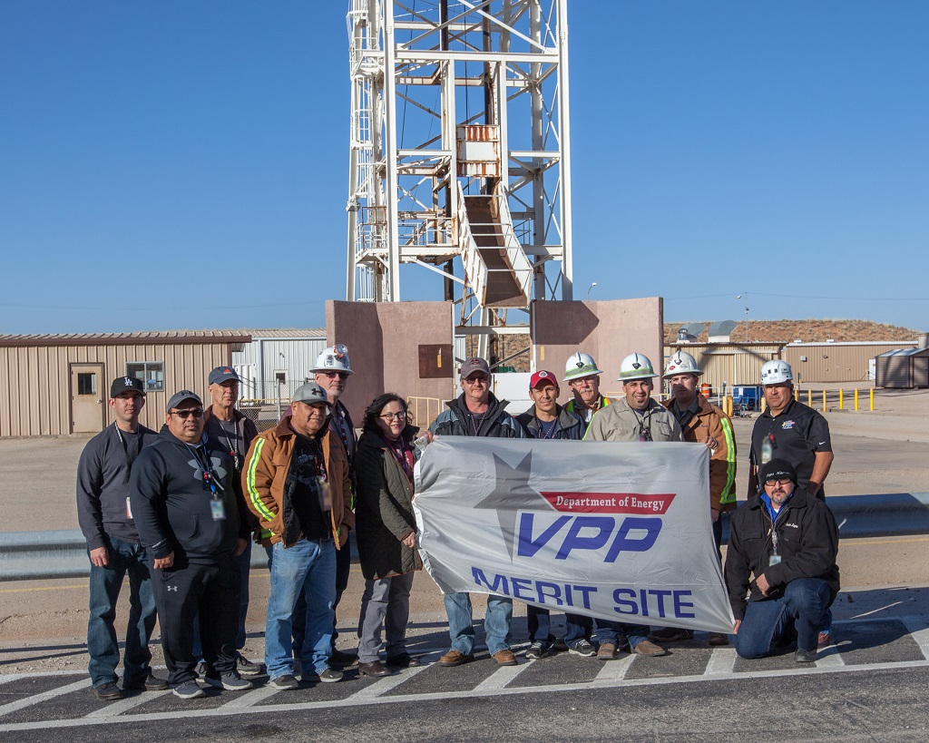 WIPP employees with VPP banner
